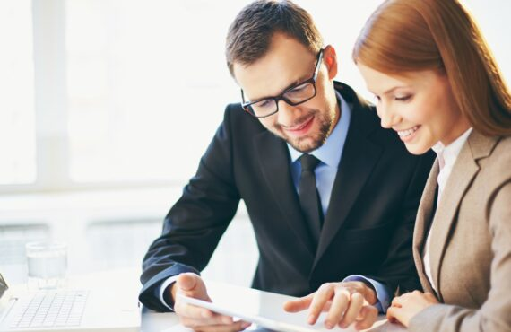 Young businessman explaining ideas to his colleague at meeting